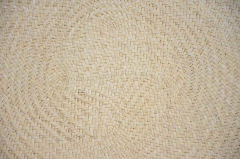 Kiskadee Design Close up product image of the woven fibers of an iraca placemat in its natural color