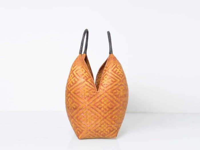 Kiskadee Design Side View Image of a Yellow Spider Pattern and Black Handles 27 inches High Cuatro Tetas Basket by the Eperaara Siapidaara tribe in Guapi Cauca