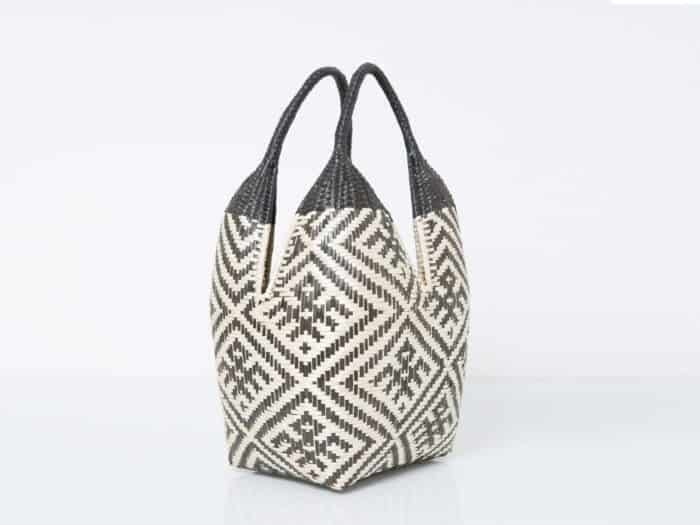 Kiskadee Design Catalogue Image of a Beige and Black Spider Pattern with Black Handles 20 inches High Cuatro Tetas Basket handwoven in Colombia