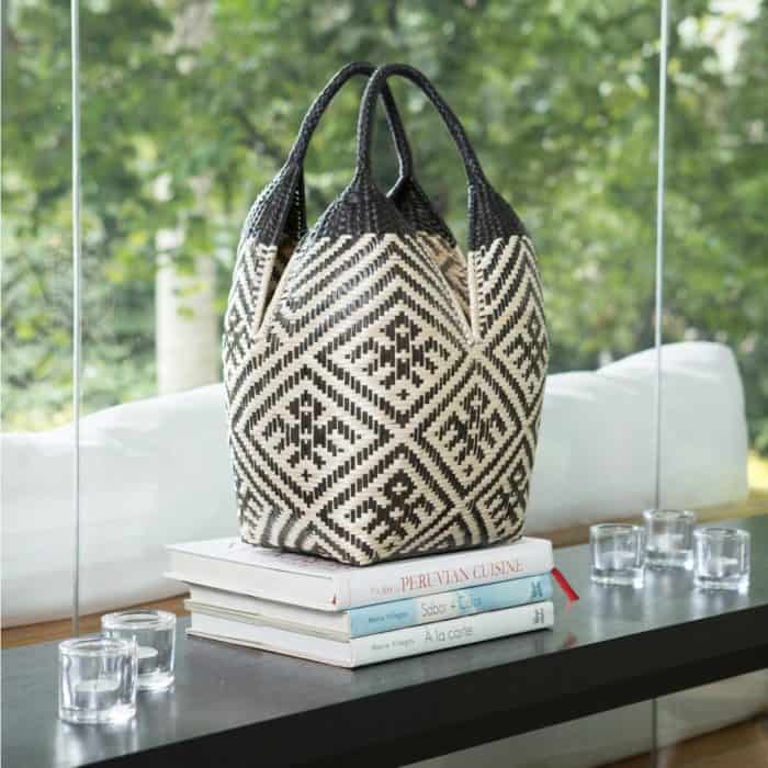 Kiskadee Design Image with Product being Used for decor of a Beige and Black Spider Pattern with Black Handles 20 inches High Cuatro Tetas Basket handwoven in Colombia