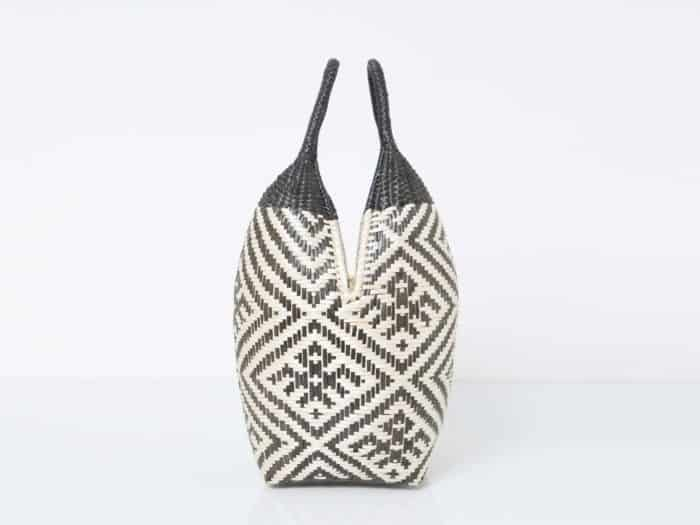 Kiskadee Design Side View Image of a Beige and Black Spider Pattern with Black Handles 20 inches High Cuatro Tetas Basket handwoven in Colombia