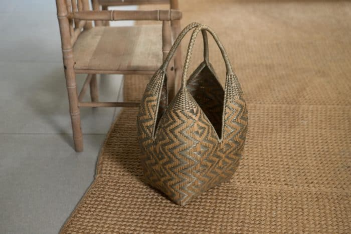 Kiskadee Design Image with Product being Used as home decor of a Grey and Beige Butterfly Pattern 20 inches High Cuatro Tetas Basket handwoven in Guapi Colombia