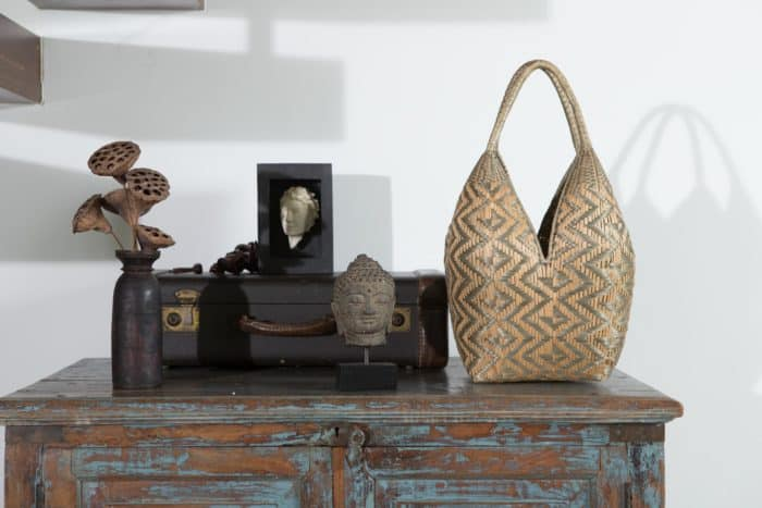 Kiskadee Design Image with Product being Used as table decor of a Grey and Beige Butterfly Pattern 20 inches High Cuatro Tetas Basket handwoven in Guapi Colombia