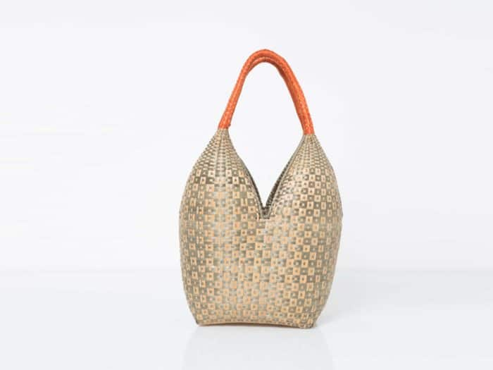 Kiskadee Design Front View Image of a Tan and Light Green Button Pattern with Orange Handles 20 inches High Cuatro Tetas Basket handmade in Colombia