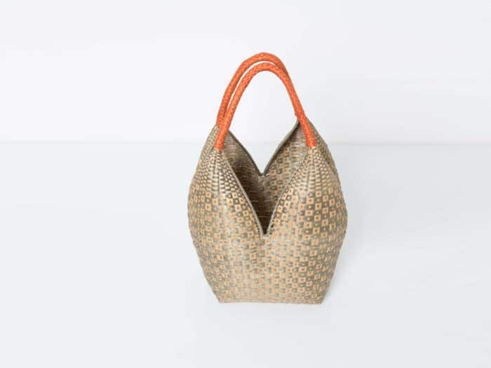 Kiskadee Design Top View Image of a Tan and Light Green Button Pattern with Orange Handles 20 inches High Cuatro Tetas Basket handmade in Colombia