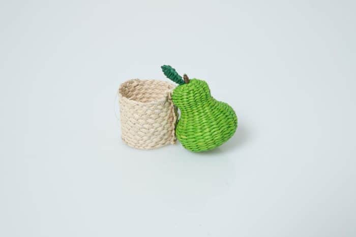 Kiskadee Design pear napkin ring hanwoven from Iraca natural fibers