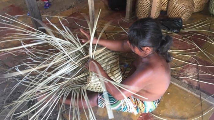 Kiskadee Design Image of an Embera Dobida Woman Weaving an Iraca Basket in Choco Colombia