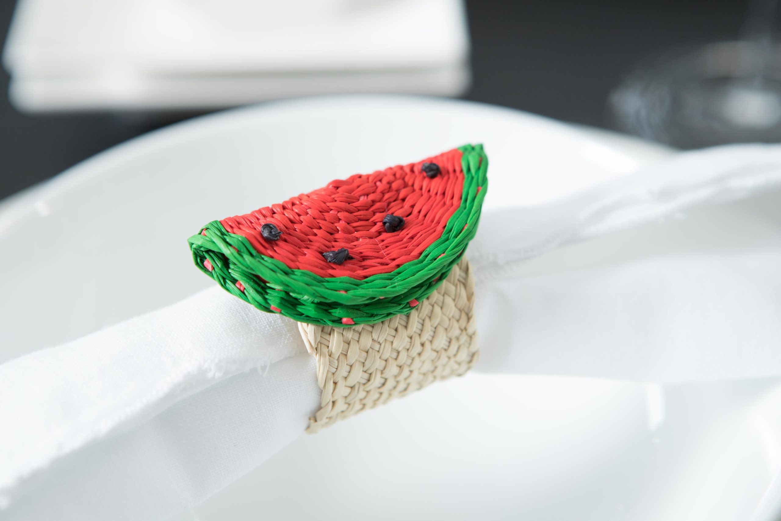 picture of an iraca handmade napkin ring in the shape of a watermelon