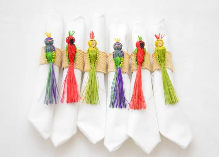 Kiskadee Design Catalogue Image of a Beautiful table accents. Made in Sandona Narino Natural fiber bird napkin rings handmadein Colombia with natural iraca fibers