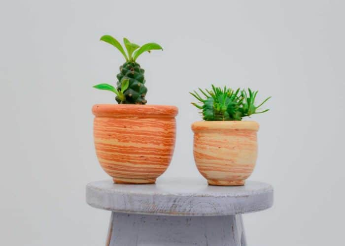 Kiskadee Design Catalogue Image of a Made in Raquira Sunset swirl small pot set Natural clay, made in Colombia