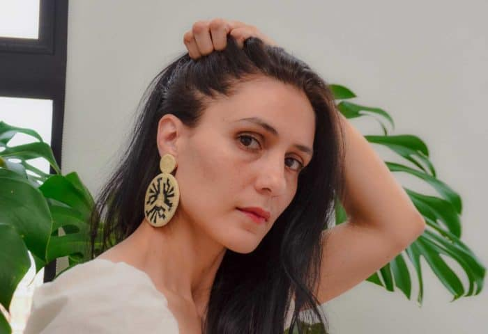 Kiskadee Design Image with Product being Used of a Beautiful accessories made by members of the Wounaan Indigenous tribe Werregue double circle earring, Natural handmadein Colombia with natural Werregue fibers