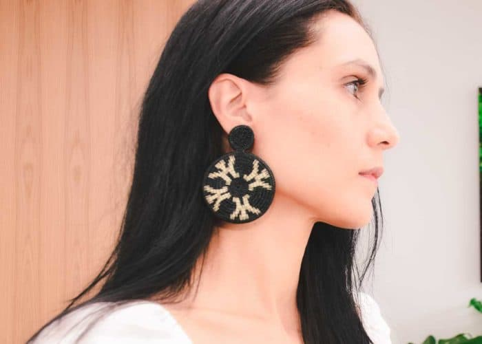 Kiskadee Design Side View Image of a Beautiful accessories made by members of the Wounaan Indigenous tribe Werregue double circle earring, black handmadein Colombia with natural Werregue fibers