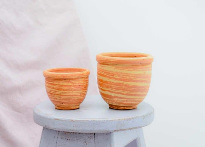 Kiskadee Design Side View Image of a Made in Raquira Sunset swirl pot set Natural clay, made in Colombia