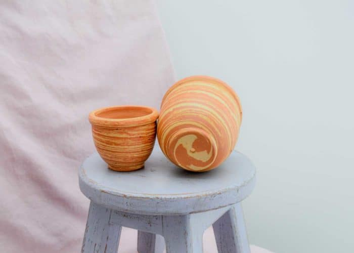 Kiskadee Design Front View Image of a Made in Raquira Sunset swirl pot set Natural clay, made in Colombia