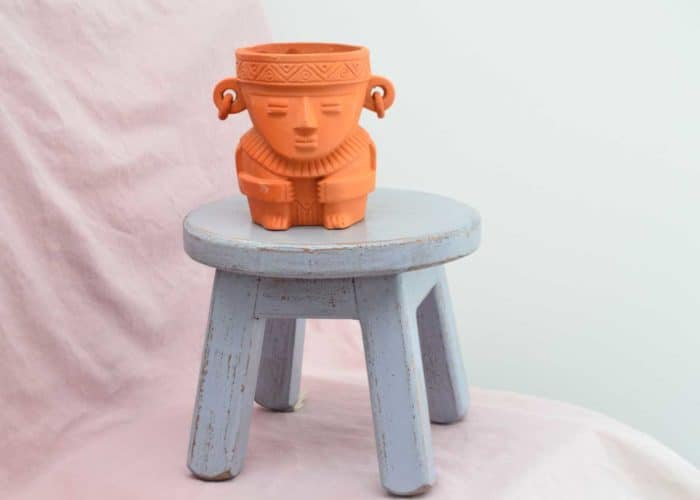 Kiskadee Design Front View Image of a Made in Raquira Sitting shaman plant pot Natural clay, made in Colombia