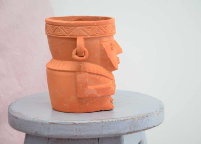 Kiskadee Design Side View Image of a Made in Raquira Sitting shaman plant pot Natural clay, made in Colombia