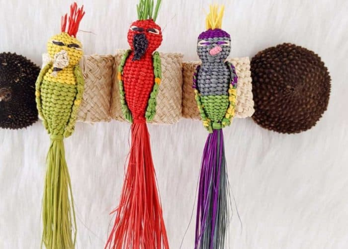 Kiskadee Design Close Up Image of a Beautiful table accents. Made in Sandona Narino Natural fiber bird napkin rings handmadein Colombia with natural iraca fibers