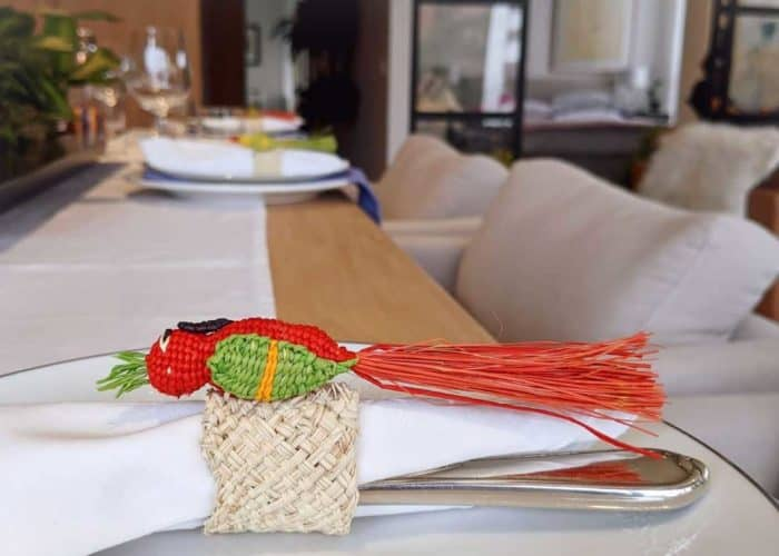 Kiskadee Design Image with Product being Used of a Beautiful table accents. Made in Sandona Narino Natural fiber bird napkin rings handmadein Colombia with natural iraca fibers