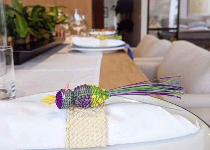 Kiskadee Design Image with Product being Used 3 of a Beautiful table accents. Made in Sandona Narino Natural fiber bird napkin rings handmadein Colombia with natural iraca fibers