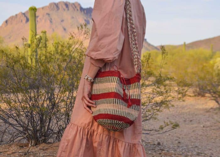 Kiskadee Design Image with Product being Used 3 of a Made by women from the Kankuamo tribe in the Sierra Nevada de Santa Marta - Colombia Handwoven Kankuamo Fique Mochila - GOYA handmade woven shoulder bag in colorful pattern