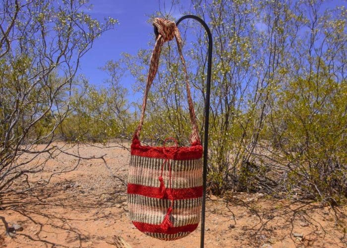 Front View Image handmade woven shoulder bag in colorful pattern Made by women from the Kankuamo tribe in the Sierra Nevada de Santa Marta - Colombia