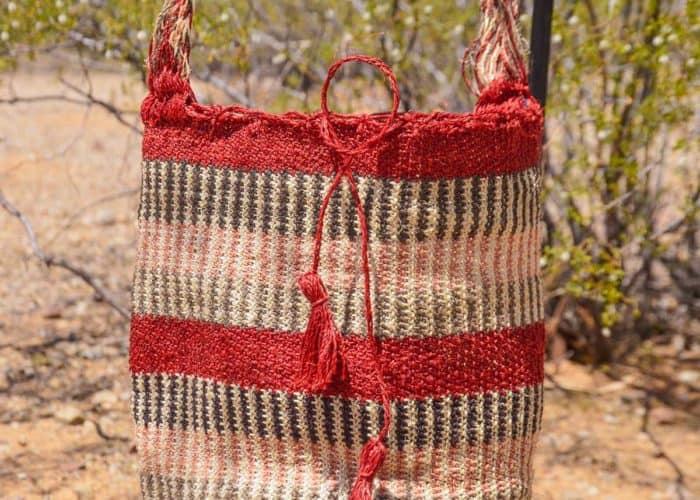 Kiskadee Design Close Up Image of a Made by women from the Kankuamo tribe in the Sierra Nevada de Santa Marta - Colombia Handwoven Kankuamo Fique Mochila - GOYA handmade woven shoulder bag in colorful pattern