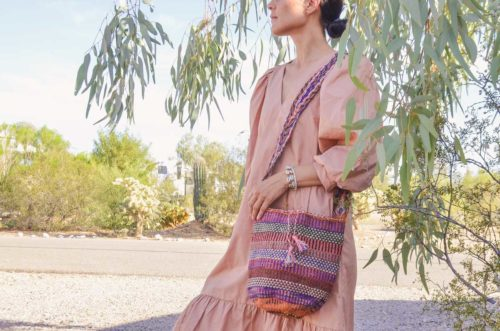 Kiskadee Design Image with Product being Used 2 of a Made by women from the Kankuamo tribe in the Sierra Nevada de Santa Marta - Colombia Handwoven Kankuamo Fique Mochila - LA MINA handmade woven shoulder bag in colorful pattern