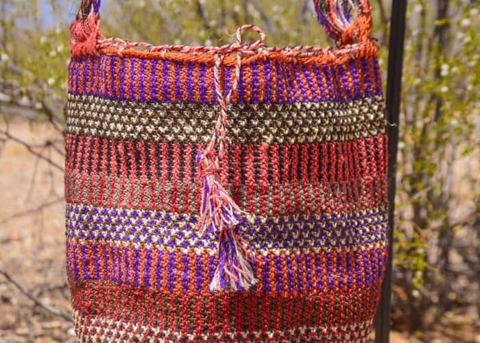 Kiskadee Design Close Up Image of a Made by women from the Kankuamo tribe in the Sierra Nevada de Santa Marta - Colombia Handwoven Kankuamo Fique Mochila - LA MINA handmade woven shoulder bag in colorful pattern