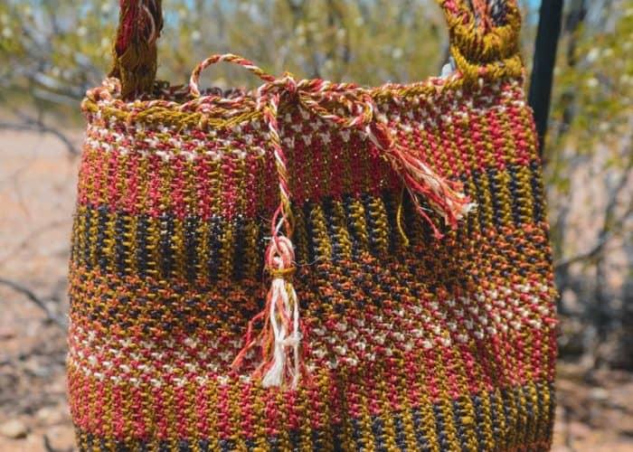 Kiskadee Design Close Up Image of a Made by women from the Kankuamo tribe in the Sierra Nevada de Santa Marta - Colombia Handwoven Kankuamo Fique Mochila - LOS HATICOS handmade woven shoulder bag in colorful pattern
