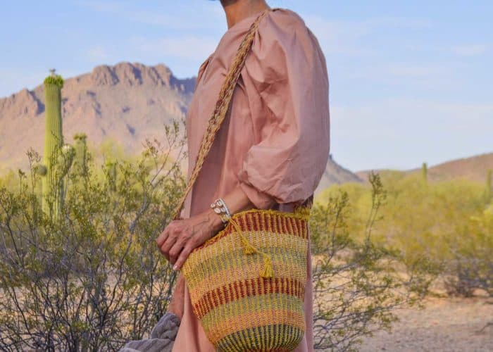 Kiskadee Design Image with Product being Used of a Made by women from the Kankuamo tribe in the Sierra Nevada de Santa Marta - Colombia Handwoven Kankuamo Fique Mochila - MOJAO handmade woven shoulder bag in colorful pattern