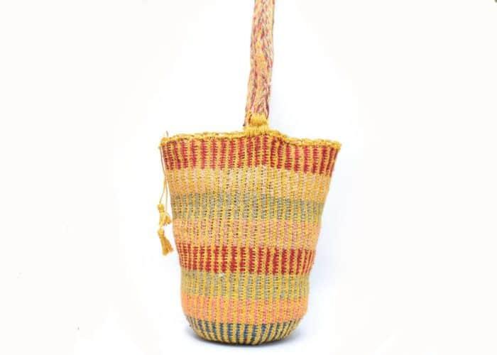 Kiskadee Design Side View Image of a Made by women from the Kankuamo tribe in the Sierra Nevada de Santa Marta - Colombia Handwoven Kankuamo Fique Mochila - MOJAO handmade woven shoulder bag in colorful pattern