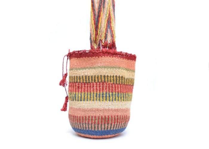 Kiskadee Design Side View Image of a Made by women from the Kankuamo tribe in the Sierra Nevada de Santa Marta - Colombia Handwoven Kankuamo Fique Mochila handmade woven shoulder bag in colorful pattern - 2