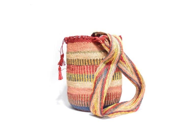 Kiskadee Design Side View Image of a Made by women from the Kankuamo tribe in the Sierra Nevada de Santa Marta - Colombia Handwoven Kankuamo Fique Mochila handmade woven shoulder bag in colorful pattern