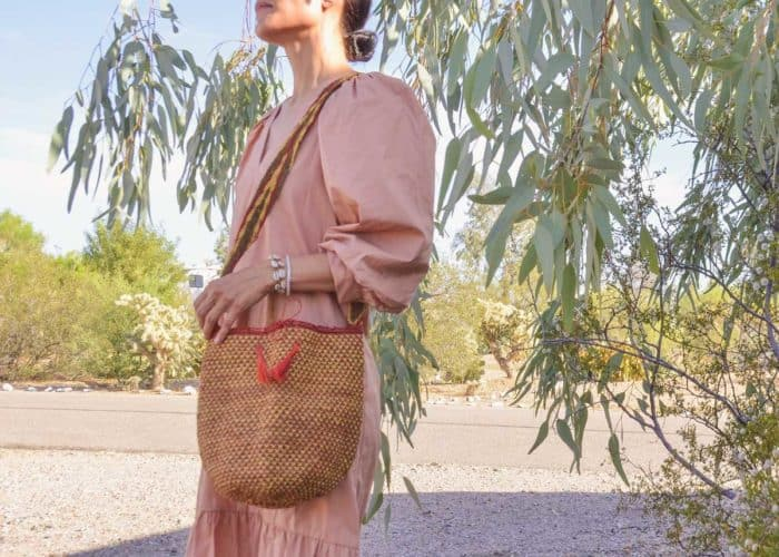 Kiskadee Design Image with Product being Used 2 of a Made by women from the Kankuamo tribe in the Sierra Nevada de Santa Marta - Colombia Handwoven Kankuamo Fique Mochila - RAMALITO handmade woven shoulder bag in colorful pattern
