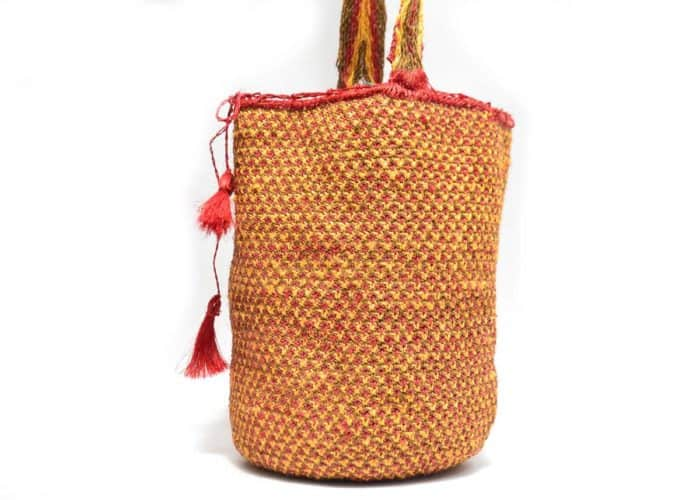 Kiskadee Design Side View Image of a Made by women from the Kankuamo tribe in the Sierra Nevada de Santa Marta - Colombia Handwoven Kankuamo Fique Mochila - RAMALITO handmade woven shoulder bag in colorful pattern